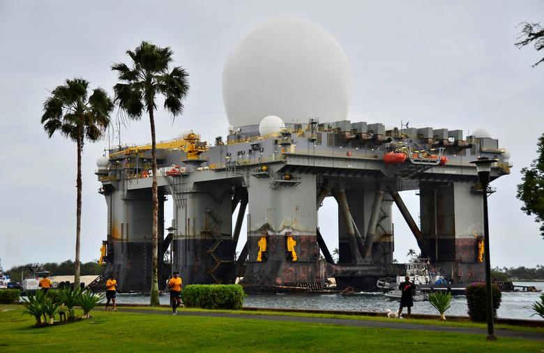 The Sea-based, X-band Radar (SBX 1), a combination of the world's largest phased-array X-band radar carried aboard a mobile, ocean-going semi-submersible oil platform, transits the waters of Joint Base Pearl Harbor-Hickam, Hawaii, U.S. on March 22, 2013.  Courtesy Daniel Barker/U.S. Navy/Handout via REUTERS   ATTENTION EDITORS - THIS IMAGE WAS PROVIDED BY A THIRD PARTY. EDITORIAL USE ONLY.