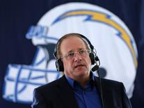 San Diego Chargers' President and Chief Executive Dean Spanos wears a headset during an interview at the NFL team's headquarters in San Diego, California January 9, 2013. REUTERS/Mike Blake