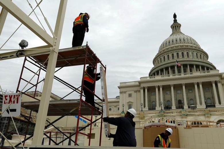 Workers construct the viewing stands ahead of U.S. President-elect Donald Trump's January inauguration at the U.S. Capitol in Washington, U.S., December 8, 2016.  REUTERS/Jonathan Ernst