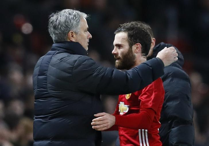 Britain Football Soccer - Manchester United v Hull City - EFL Cup Semi Final First Leg - Old Trafford - 10/1/17 Manchester United's Juan Mata hugs manager Jose Mourinho as he is substituted    Action Images via Reuters / Jason Cairnduff Livepic