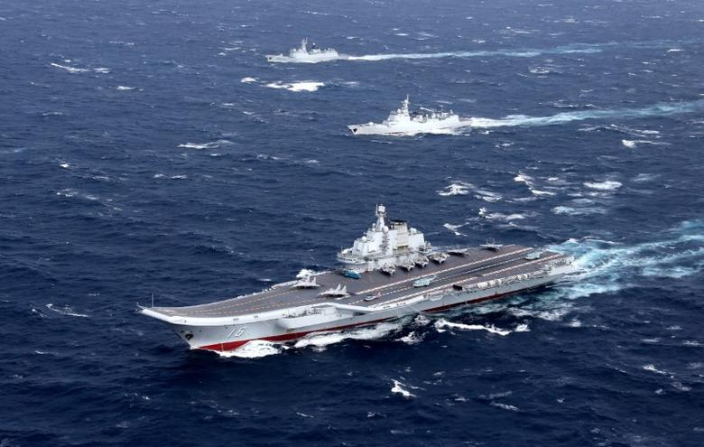 China's Liaoning aircraft carrier with accompanying fleet conducts a drill in an area of South China Sea, in this undated photo taken December, 2016. REUTERS/Stringer/Files