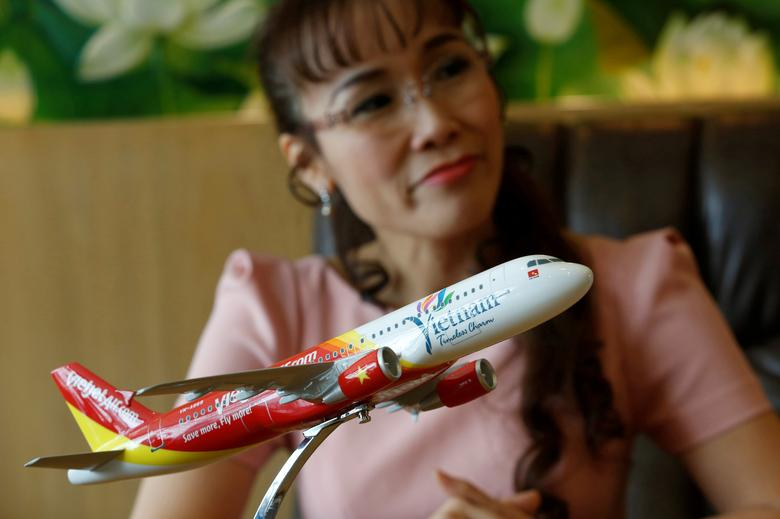 FILE PHOTO: VietJet Air CEO Nguyen Thi Phuong Thao speaks behind a model of a VietJet aircraft during an interview in her office in Ho Chi Minh City, Vietnam, January 10, 2017. REUTERS/Kham/File Photo