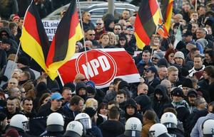 Supporters of anti-immigration right-wing movement PEGIDA protest in...