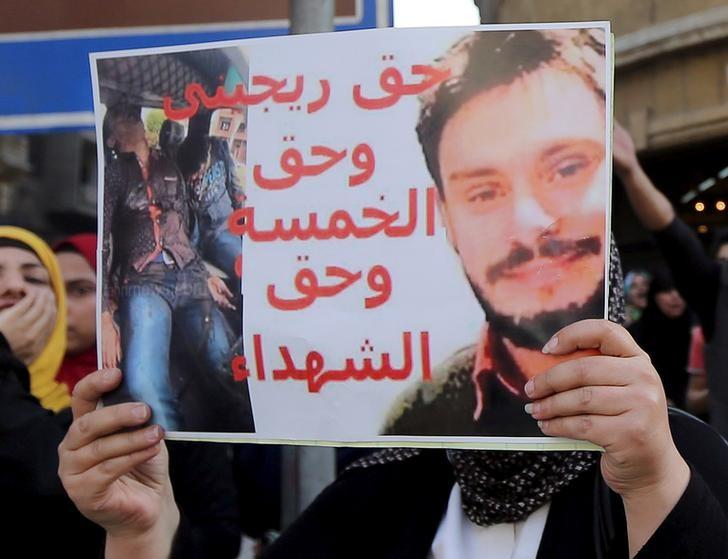 An Egyptian activist holds a poster calling for justice to be done in the case of the recently murdered Italian student Giulio Regeni during a demonstration protesting the government's decision to transfer two Red Sea islands to Saudi Arabia, in front of the Press Syndicate in Cairo, Egypt, April 15, 2016.   REUTERS/Staff/File Photo   TEMPLATE OUT