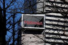 The logo of Toshiba Corp is seen behind trees at its headquarters in Tokyo, Japan January 23, 2017.    REUTERS/Toru Hanai