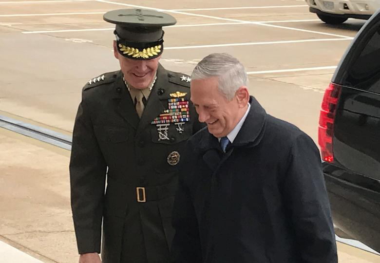 New U.S. Defense Secretary James Mattis (R) is greeted by Marine General Joseph Dunford, chairman of the Joint Chiefs of Staff, as he arrives for his first day of work at the Pentagon outside Washington, U.S., January 21, 2017. REUTERS/Phil Stewart
