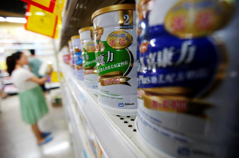 Abbott's milk powder products are displayed on a shelf at a supermarket in Beijing August 7, 2013.  REUTERS/Kim Kyung-Hoon/File Photo