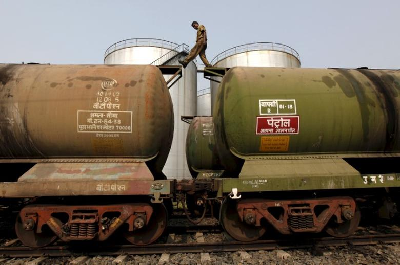 FILE PHOTO: A worker walks atop a tanker wagon to check the freight level at an oil terminal on the outskirts of Kolkata, India November 27, 2013. REUTERS/Rupak De Chowdhuri/File Photo - RTSXE0K