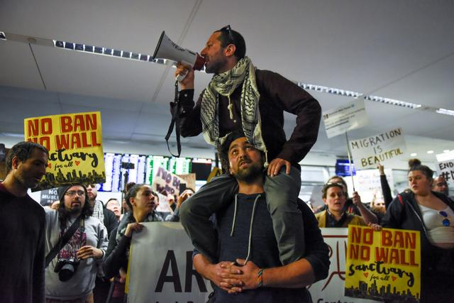 Demonstrators shout slogans during anti-Donald Trump immigration ban protests inside Terminal 4 at San Francisco International Airport in San Francisco, California, U.S., January 28, 2017. REUTERS/Kate Munsch