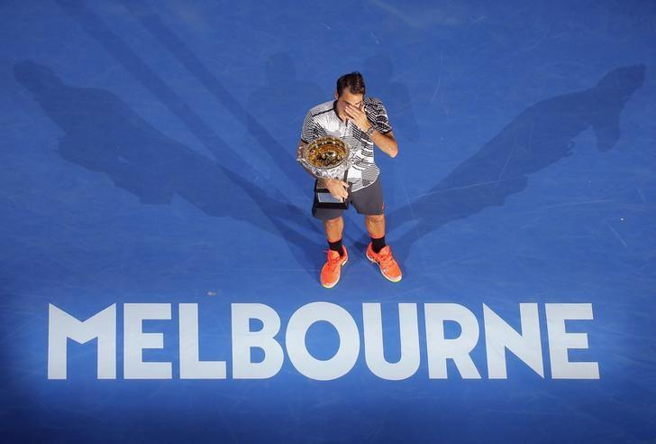 Tennis - Australian Open - Melbourne Park, Melbourne, Australia - 29/1/17  Switzerland's Roger Federer holds the trophy after winning his Men's singles final match against Spain's Rafael Nadal. REUTERS/Jason Reed