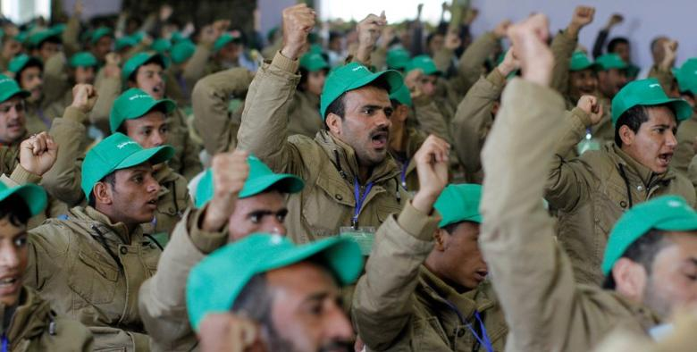 Pro-Houthi fighters, who have been injured during recent fighting, shout slogans during a rally held to honour those injured or maimed while fighting in Houthi ranks in Sanaa, Yemen, January 29, 2017. REUTERS/Mohamed al-Sayaghi