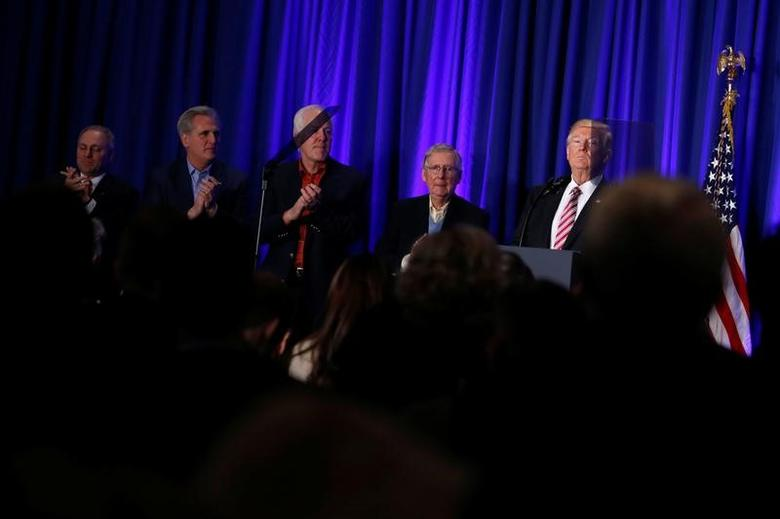 U.S. President Donald Trump (R), flanked by U.S. Representative Steve Scalise (R-LA) (from L), Representative Kevin McCarthy (R-CA), Senator John Cornyn (R-TX), and Senate Majority Leader Mitch McConnell (R-KY), receives a standing ovation as he speaks at a congressional Republican retreat in Philadelphia, U.S. January 26, 2017.  REUTERS/Jonathan Ernst