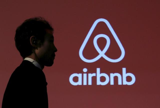 A man walks past a logo of Airbnb after a news conference in Tokyo, Japan, November 26, 2015. REUTERS/Yuya Shino/File Photo - RTX2RC1X