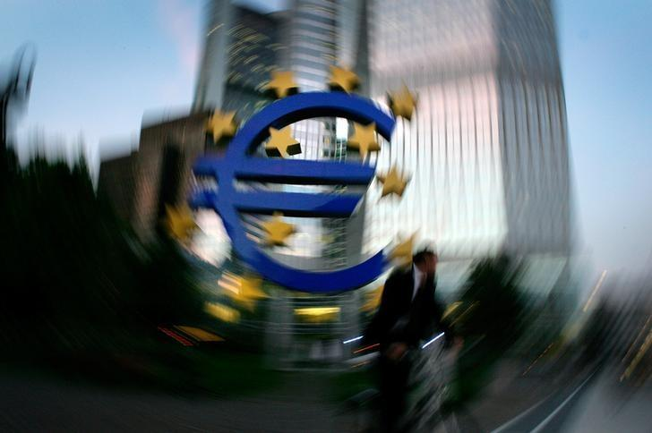 FILE PHOTO: The euro sculpture in front of the European Central Bank headquarters in Frankfurt October 4, 2006. REUTERS/Kai Pfaffenbach/File Photo