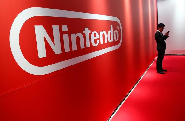 A man stands in front of Nintendo's logo at the presentation ceremony of its new game console Switch in Tokyo, Japan January 13, 2017. REUTERS/Kim Kyung-Hoon