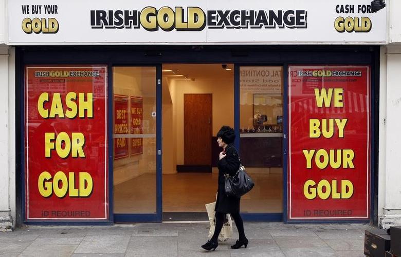 A pedestrian walks past a shop in Dublin November 16, 2010.   REUTERS/Cathal McNaughton