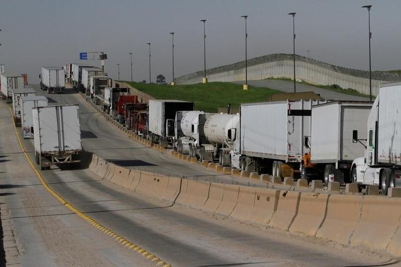 Trucks wait in a long queue for border customs control to cross into the U.S. at the Otay border crossing in Tijuana, Mexico, February 2, 2017. REUTERS/Jorge Duenes