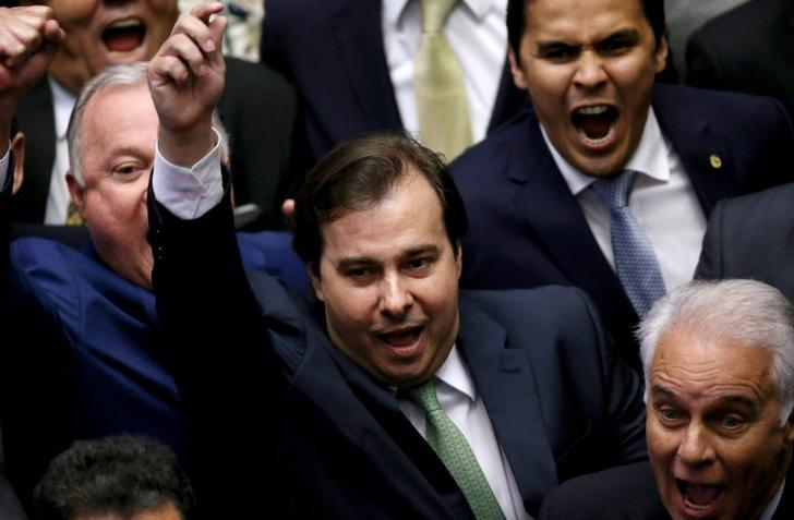 Congressman Rodrigo Maia, of the center-right Democrats party (C), celebrates after being re-elected to the lower house of Brazil's Congress in Brasilia, Brazil, February 2, 2017. REUTERS/Adriano Machado