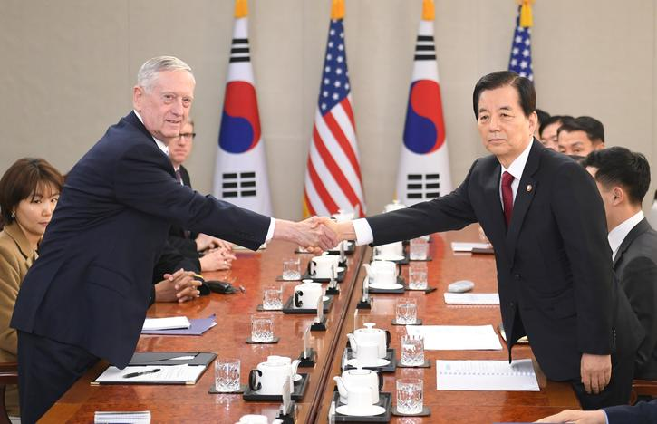 U.S. Defense Secretary Jim Mattis (L) shakes hands with South Korean Defense Minister Han Min-Koo (R) before their meeting at the headquarters of the Defense Ministry in Seoul, South Korea, February 3, 2017. REUTERS/Kim Min-Hee/Pool