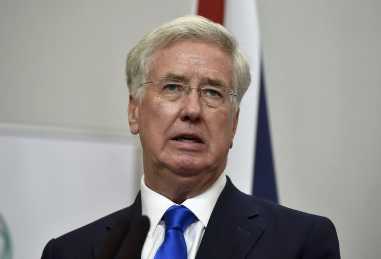 FILE PHOTO - Britain's Defence Secretary Michael Fallon attends a press conference with U.S. Secretary of Defence Ash Carter at the Foreign Office in London, December 15, 2016. REUTERS/Hannah McKay/File Photo