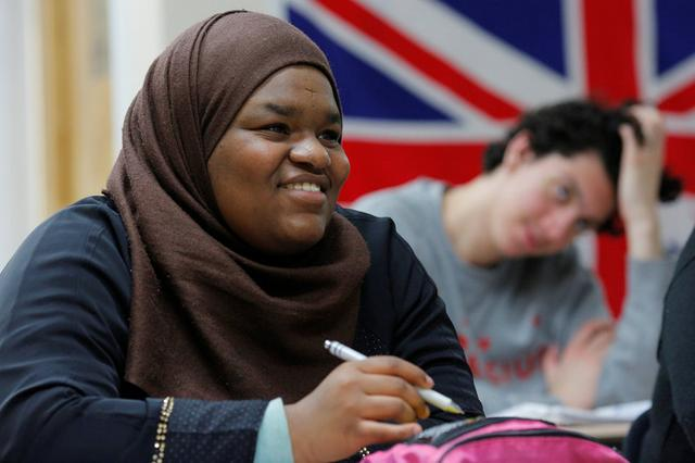 Tenth grade student Ayia Elsadig listens as Nadeem Mazen, Cambridge city councillor, Muslim and founder of JetPAC, speaks to her AP Government class at Al-Noor Islamic high school in Mansfield, Massachusetts, U.S. February 2, 2017. Picture taken February 2, 2017. REUTERS/Brian Snyder