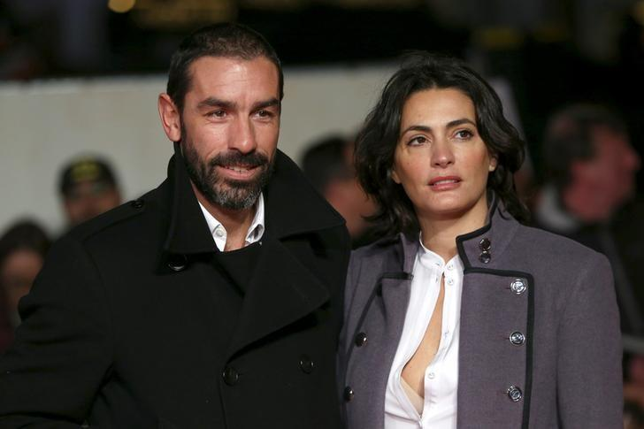 Former footballer Robert Pires (L) and wife Jessica Lemarie pose for photographers at the world premiere of the film ''I am Bolt'' in London, Britain November 28, 2016. REUTERS/Neil Hall/File Photo