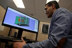 Product Development Engineer Jigar Patel works with a CAD image of a thrust reverser cascade in development at Oxford Performance Materials Inc., the maker of more than 600 parts to be used on Boeing's new Starliner manned spacecraft, in South Windsor, Connecticut, the maker of more than 600 parts to be used on Boeing's new Starliner manned spacecraft, in South Windsor, Connecticut, U.S., January 31, 2017. REUTERS/Mike Segar