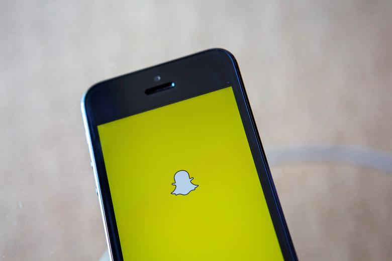 FILE PHOTO - A portrait of the Snapchat logo in Ventura, California December 21, 2013. REUTERS/Eric Thayer/File Photo