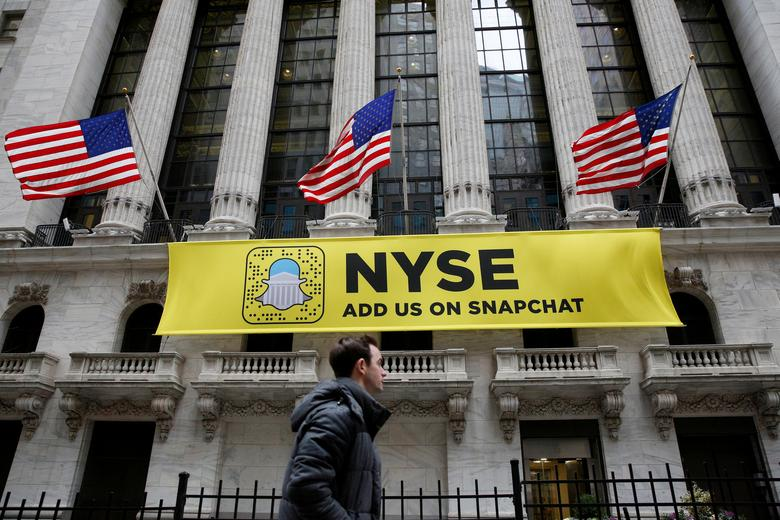 FILE PHOTO - A Snapchat sign hangs on the facade of the New York Stock Exchange (NYSE) in New York City, U.S., January 23, 2017.  REUTERS/Brendan McDermid/File Photo