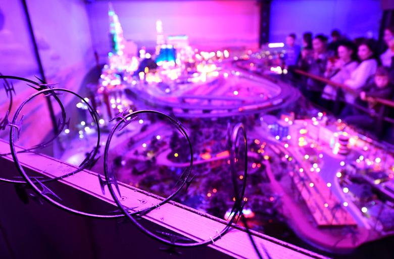 A wall with barbed wire on its top is seen in front of the skyline of Las Vegas at the exposition ''Miniature-Wonderland'' in Hamburg, Germany, February 3, 2017.  REUTERS/Fabian Bimmer