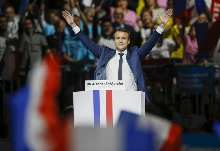 Emmanuel Macron, head of the political movement En Marche !, or Onwards !, and candidate for the 2017 presidential election, reacts after delivering his speech during a campaign rally in Lyon, France, February 4, 2017. REUTERS/Robert Pratta