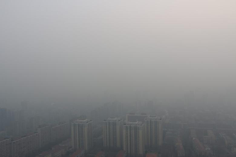 Residential buildings are seen in smog during a polluted day in Beijing, China, February 4, 2017. REUTERS/Stringer