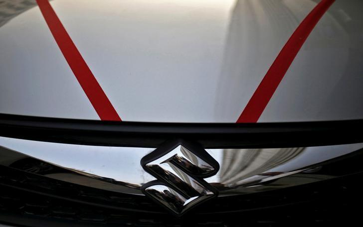 The logo of Maruti Suzuki India Limited is seen on car parked outside a showroom in New Delhi, India, February 29, 2016. REUTERS/Anindito Mukherjee/File Photo