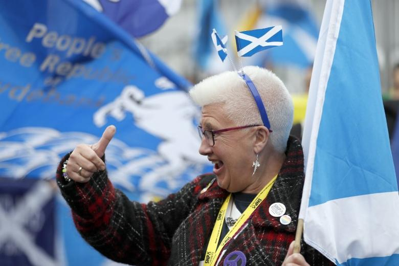A woman gestures at a pro Independence rally held outside the SNP conference in Glasgow, Scotland October 15, 2016. REUTERS/Russell Cheyne