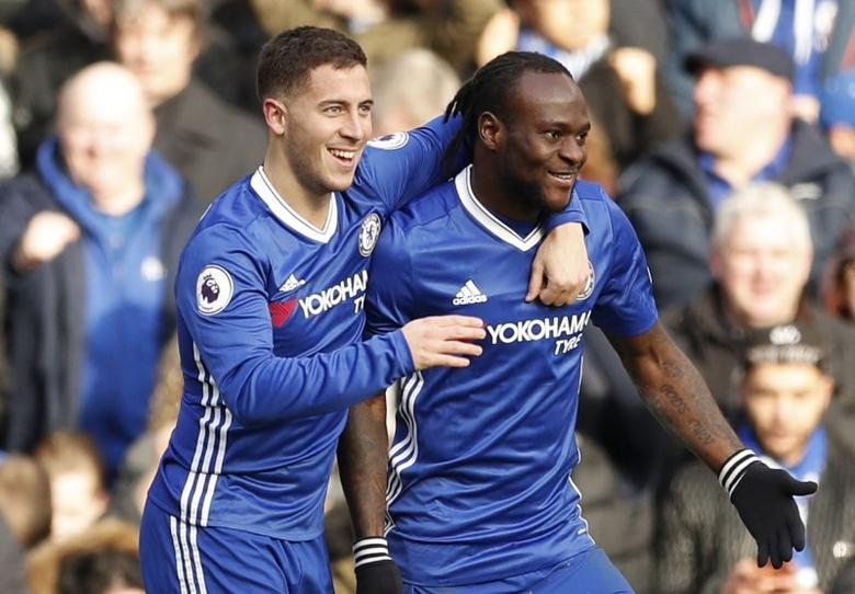 Britain Football Soccer - Chelsea v Arsenal - Premier League - Stamford Bridge - 4/2/17 Chelsea's Eden Hazard celebrates scoring their second goal with Victor Moses Action Images via Reuters / John Sibley Livepic