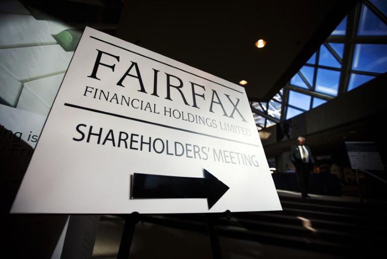 FILE PHOTO - A man walks past a Fairfax Holdings sign directing shareholders to the meeting, at the annual general meeting for shareholders in Toronto, April 9, 2014.  REUTERS/Mark Blinch