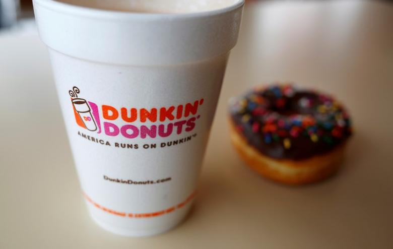 FILE PHOTO -  A drink and a doughnut are seen at a Dunkin' Donuts location in the Chicago suburb of Niles, Illinois, February 4, 2015.  REUTERS/Jim Young/File Photo