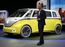 Volkswagen chairman Herbert Diess speaks near an electric I.D. Buzz concept vehicle during the North American International Auto Show in Detroit, Michigan, U.S., January 9, 2017. REUTERS/Brendan McDermid