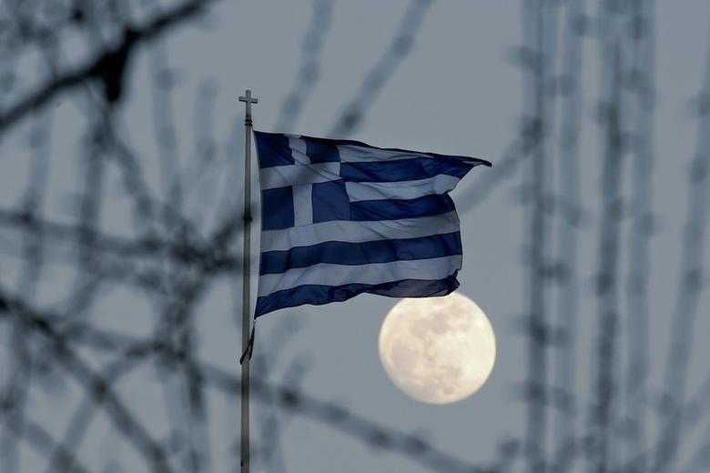 A Greek national flag flutters as the moon rises in Athens, Greece February 9, 2017. REUTERS/Alkis Konstantinidis