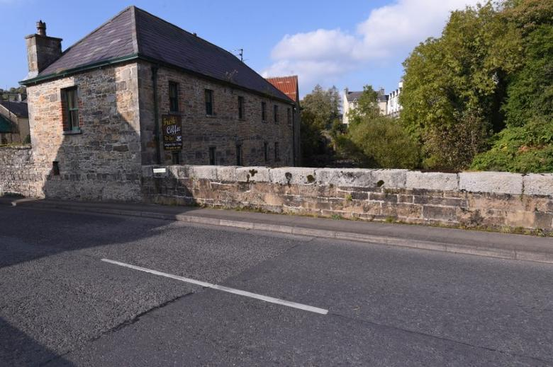 A subtle change in the texture of the road indicates the precise Republic of Ireland (left) and Northern Ireland (right) border line in the border town of Pettigo, Northern Ireland October 14, 2016. REUTERS/Clodagh Kilcoyne