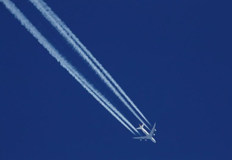 Vapour trails from a Lufthansa plane are seen in the sky over the ski resort of Val d'Isere, France, December 1, 2016. REUTERS/Christian Hartmann