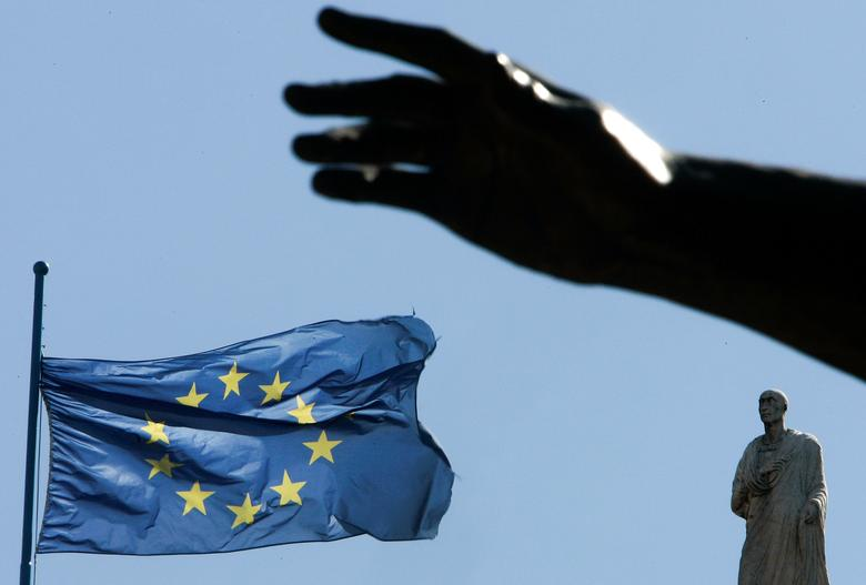 FILE PHOTO: A European Union flag flutters near the hand of a statue on Campidoglio square in central Rome, Italy, March 23 2007. REUTERS/Tony Gentile/File Photo