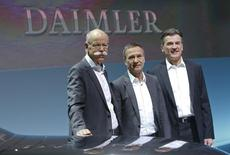 The Daimler AG management board L-R CEO Dieter Zetsche, CFO Bodo Uebber and Wolfgang Bernhard of Daimler Trucks & Buses pose behind a Mercedes EQ concept car before the car maker's annual news conference in Stuttgart, Germany, February 2, 2017.   REUTERS/Michaela Rehle