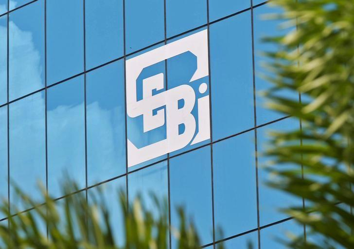 FILE PHOTO: The logo of the Securities and Exchange Board of India (SEBI), India's market regulator, is seen on the facade of its head office building in Mumbai,  July 13, 2015.   REUTERS/Shailesh Andrade