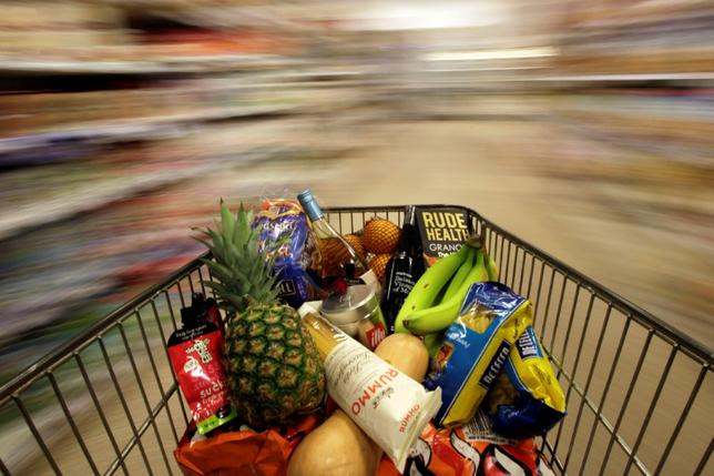 FILE PHOTO:A shopping trolley is pushed around a supermarket in London, Britain May 19, 2015. REUTERS/Stefan Wermuth/File Photo