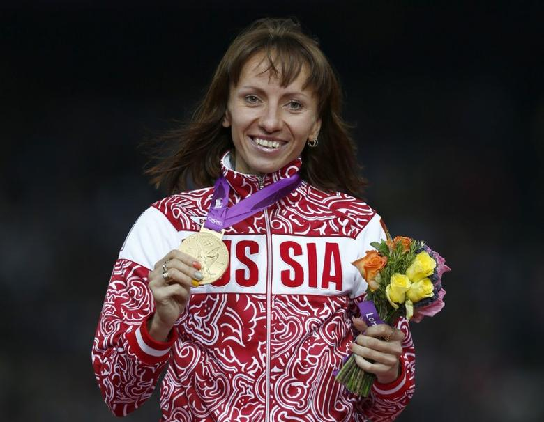 Russia's Mariya Savinova holds her gold medal during the women's 800m victory ceremony at the London 2012 Olympic Games at the Olympic Stadium August 11, 2012. REUTERS/Eddie Keogh/Files