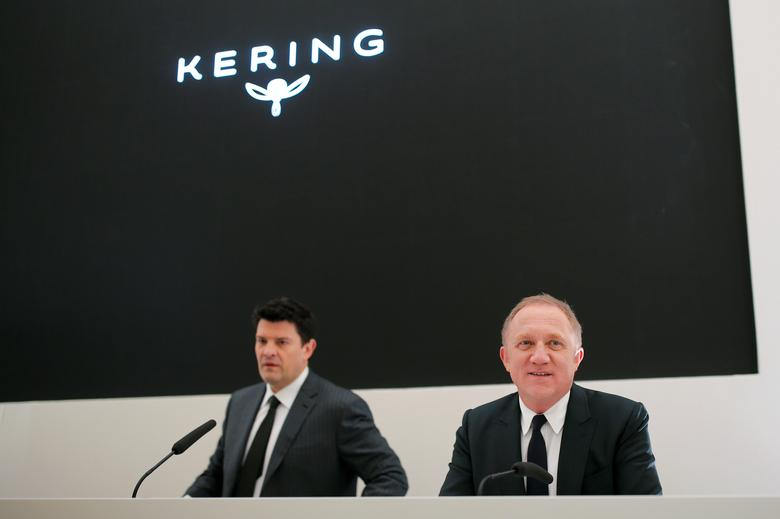 Francois-Henri Pinault (R), Chairman and chief executive officer of Kering, looks on as he sits next to Group managing director Jean-Francois Palus (L) during a press conference on the annual report for 2016 of the French luxury goods holding company in Paris, France, February 10, 2017. REUTERS/Benoit Tessier