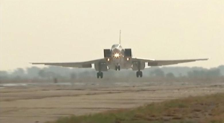 A still image, taken from video footage and released by Russia's Defence Ministry on August 18, 2016, shows a Russian Tupolev Tu-22M3 long-range bomber landing at an air base near the Iranian city of Hamadan.   Ministry of Defence of the Russian Federation/Handout via REUTERS TV