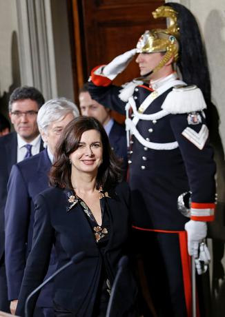 FILE PHOTO: Italy's lower house President Laura Boldrini smiles at the end of the first day of consultations with Italian President Giorgio Napolitano at the Quirinale Palace in Rome February 14, 2014. REUTERS/Remo Casilli/File Photo