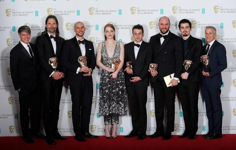 The team behind 'La La Land'' hold their awards for Best Film at the British Academy of Film and Television Awards (BAFTA) at the Royal Albert Hall in London, Britain, February 12, 2017.  REUTERS/Toby Melville